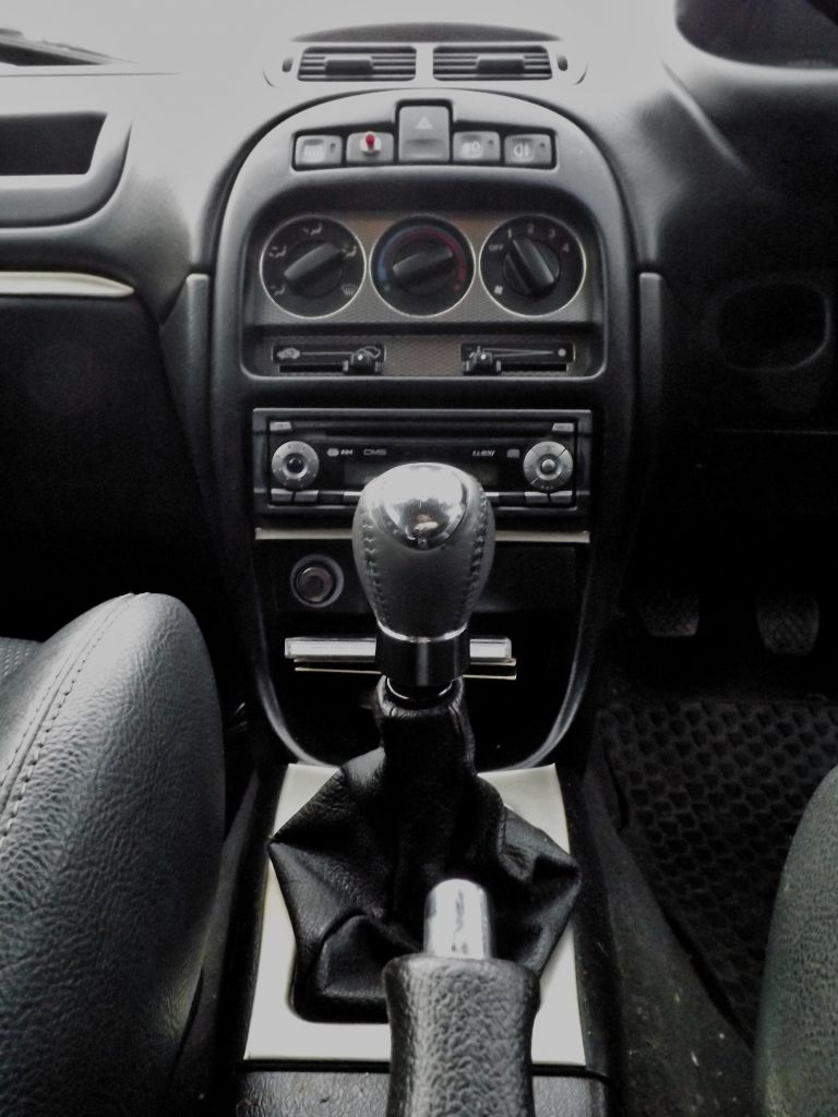 These cars have a simple console, along with a Blaupunkt stereo that my first car had!