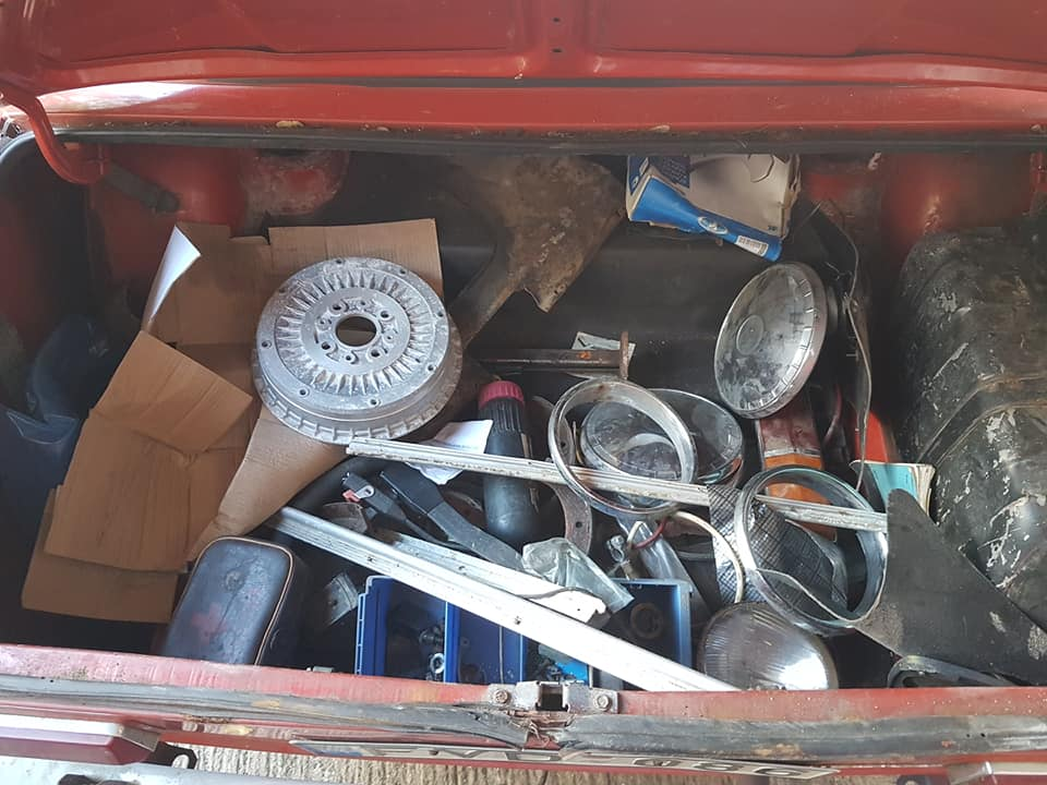 A boot full of spares for this Lada 2101. New brakes, an empty first aid kit, and a water bottle.