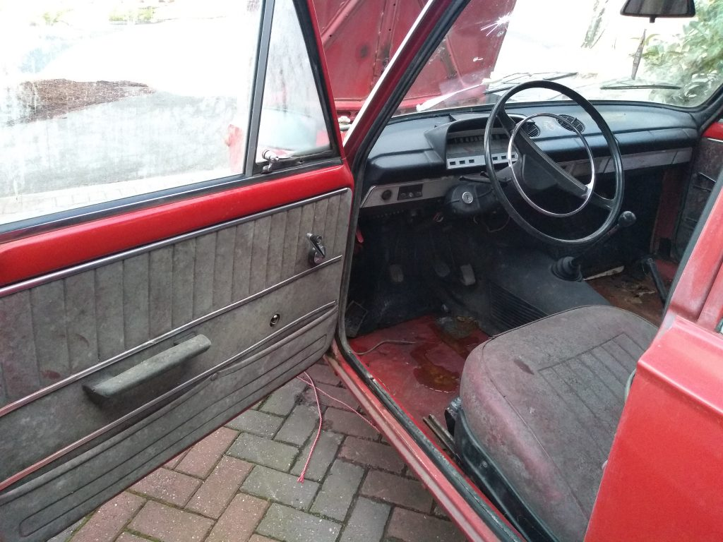 The interior of my Lada 2101 Zhiguli, as you can see the door card is extremely moldy as well as the seats.