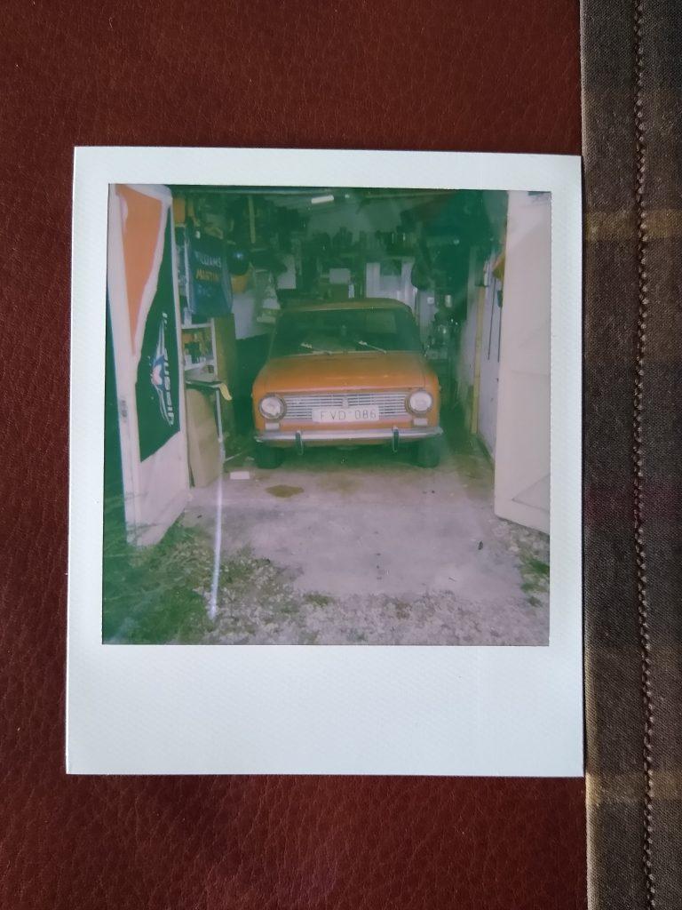 A polaroid photo of my Lada 2101 inside my garage.