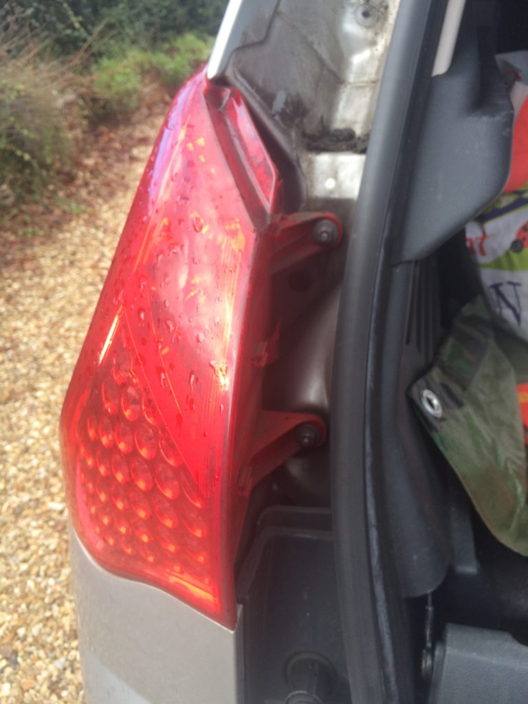 Two 10mm nuts hold the rear light cluster on to the Peugeot 3008.